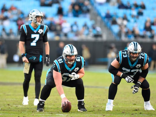 Nov 17, 2019; Charlotte, NC, USA; Carolina Panthers quarterback Kyle Allen (7) in the shotgun with center Matt Paradis (61) and offensive guard Greg Van Roten (73) at the line of scrimmage in the fourth quarter at Bank of America Stadium. Mandatory Credit: Bob Donnan-USA TODAY Sports