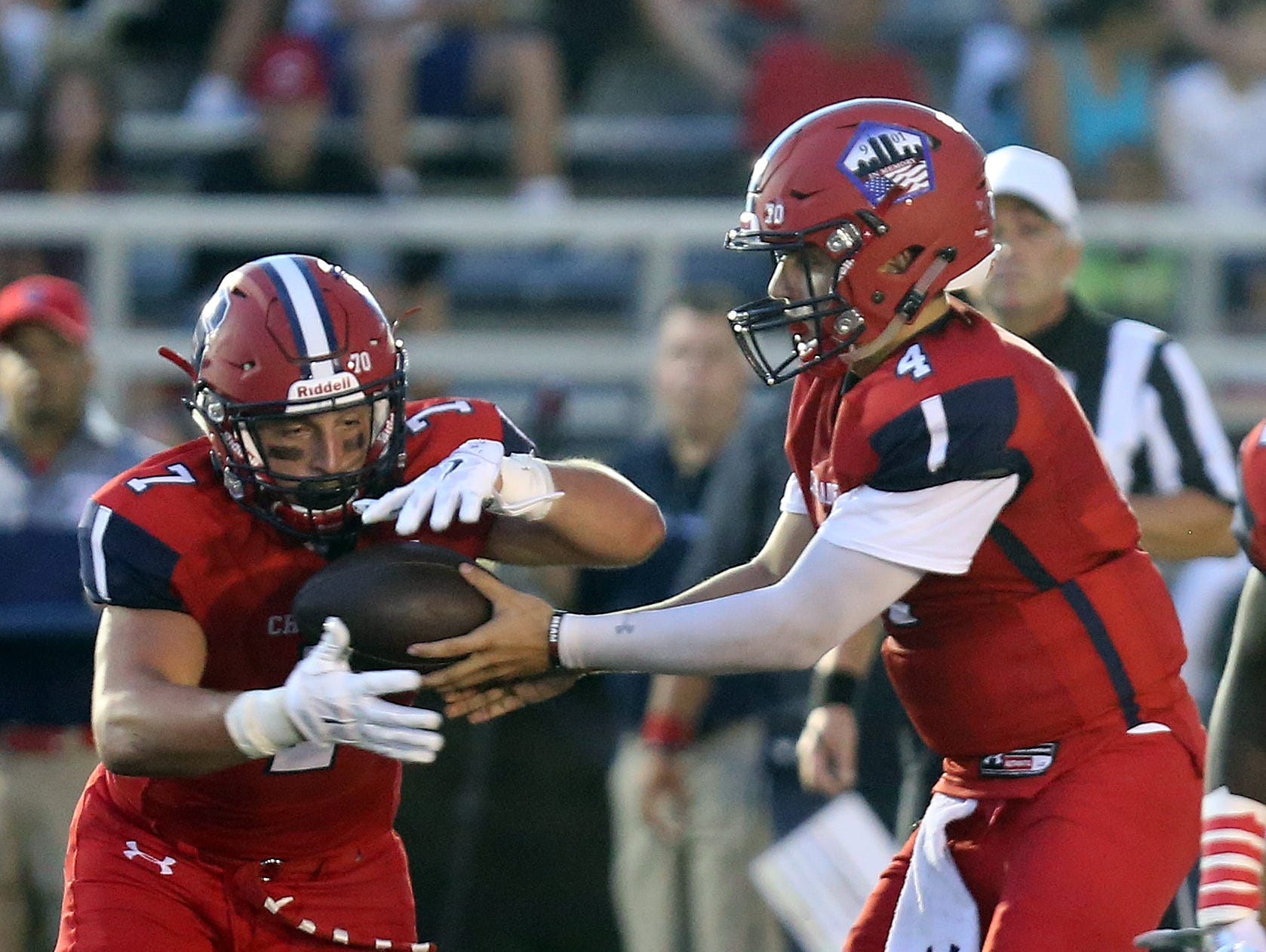 Stepinac's Quarterback Michael Nicosia (4) hands the ball off to Antonio Giannico (7) during the Joseph R. Riverso Memorial football game against Cornwall at the high school in White Plains on Sept. 9, 3016.