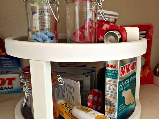 A double decker lazy Susan keeps medicines orderly and in plain sight.