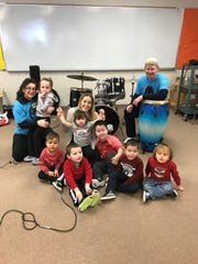 Debra and Jack Yocum with Mrs. Oliver and her class. From left: Harper, Ryan, Dante, Rhiannon, Andrew, Sean and Aiden.