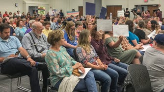 Supporters of embattled teacher John Kluge and those standing by transgender students attend a school board meeting at Brownsburg Community School's Central Office on Monday, June 11, 2018.