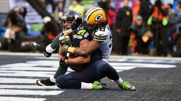 Seattle Seahawks wide receiver Jermaine Kearse (15) catches a 35 yard pass from quarterback Russell Wilson (not pictured) for the game-winning touchdown ahead of Green Bay Packers cornerback Tramon Williams (38) in overtime of the NFC Championship Game in 2015.