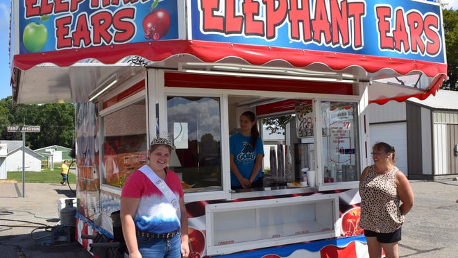 2019 Branch County 2019 Fair Queen Merannda Russell and her mother Ginger helped hand out elephant ears Sunday for the Fair Food drive thru.