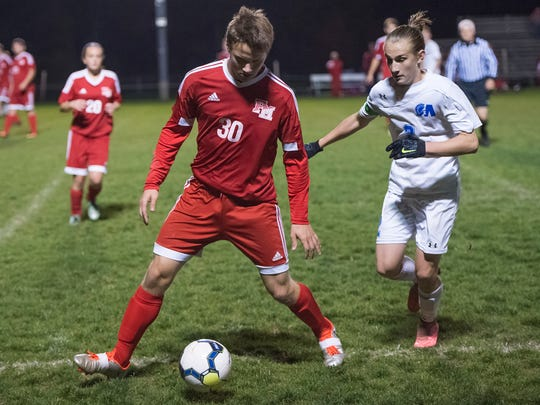 Fannett-Metal's Frankie Ryder (30) looks to make a pass while being guarded by Nic Culler (2), of McConnellsburg, during a District 5 Class 1A boys soccer semifinal on Tuesday, Nov. 1, 2016 in Everett, Pa. Fannett-Metal defeated McConnellsburg 3-2.