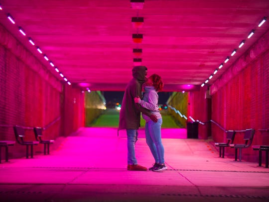 A couple kisses on Valentines Day in the tunnel leading