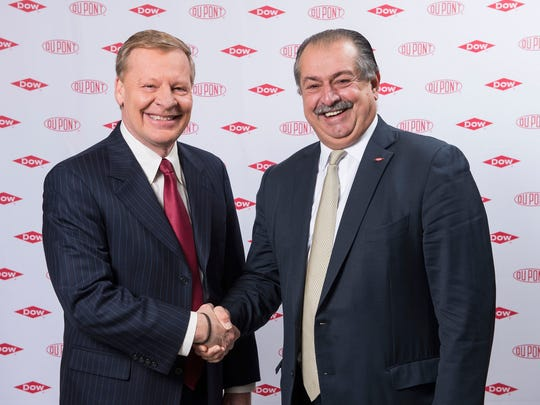 DuPont Chief Executive Ed Breen, left, shakes the hand of Dow Chemical Chief Executive Andrew Liveris in December 2015 after the two companies agreed to pursue a merger.