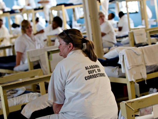 Inmates sit on their bunks Tutwiler Women's Correction