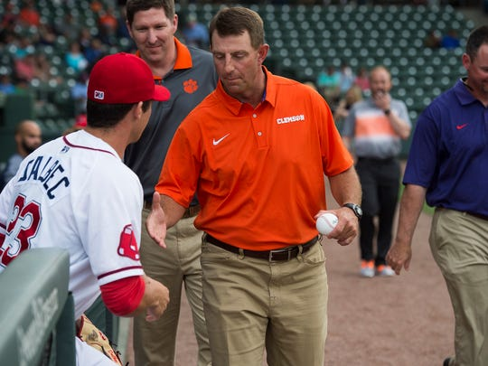 Clemson football head coach Dabo Swinney shakes hands with Bobby Dalbec of the Greenville Drive after the Prowl & Growl at Fluor Field on Wednesday, May 3, 2017.
