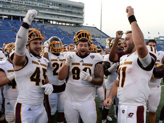 Central Michigan quarterback Shane Morris (11) and defensive lineman Joe Ostman (45) lead the team in cheer after the win against the Kansas Jayhawks at Memorial Stadium on Saturday, Sept. 9, 2017.