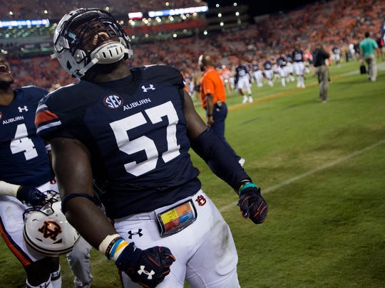 Auburn linebacker Deshaun Davis (57) celebrates after