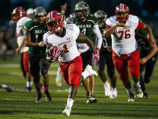 Immokalee High School's Fred Green brings the ball