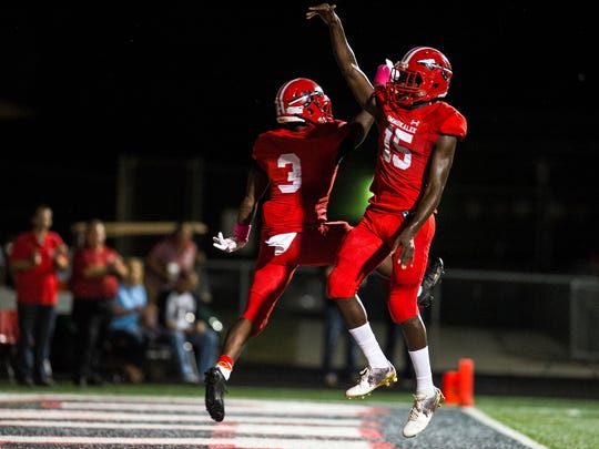 Immokalee High School's Shedro Louis(3) and Yanavis