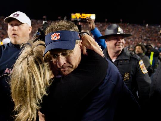 Auburn head coach Gus Malzahn embraces his wife Kristi Malzahn after the NCAA football game between Auburn and Georgia on Saturday, Nov. 11, 2017, in Auburn, Ala. Auburn defeated Georgia 40-17.