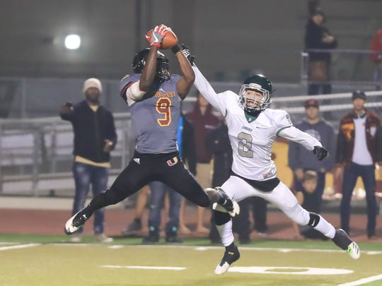 Tulare Union's Emoryie Edwards catches a pass against Dinuba in a Central Section Division II Championship high school football game at Bob Mathias Stadium on Nov. 24, 2017.
