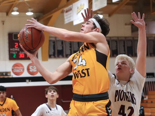 Golden West's Zach Glick attempts a shot against Mt Whitney on Tuesday in a West Yosemite League high school boys basketball game.