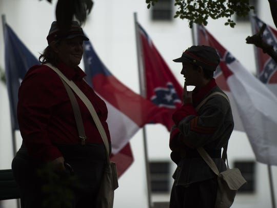 This 2017 photo shows people dressed in Confederate