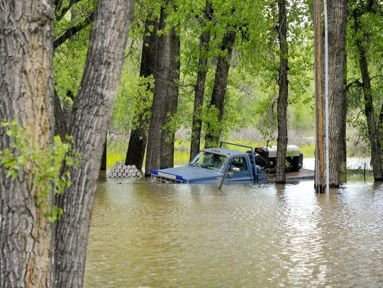 The Missouri River floods a yard in Woodland Estates,