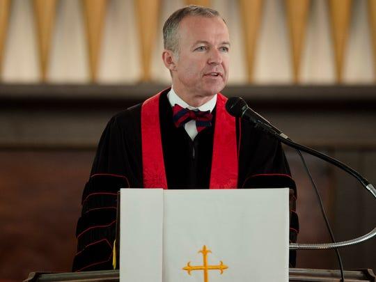 Rev. Jeremy Pridgeon gives a prayer of restoration