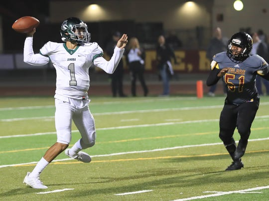 Dinuba's Josh Magana plays against Tulare Union in