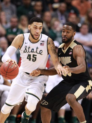 Mar 13, 2016; Indianapolis, IN, USA; Michigan State Spartans guard Denzel Valentine (45) is guarded by Purdue Boilermakers guard Raphael Davis (35) during the Big Ten conference tournament at Bankers Life Fieldhouse. Michigan State defeats Purdue 66-62. Mandatory Credit: Brian Spurlock-USA TODAY Sports