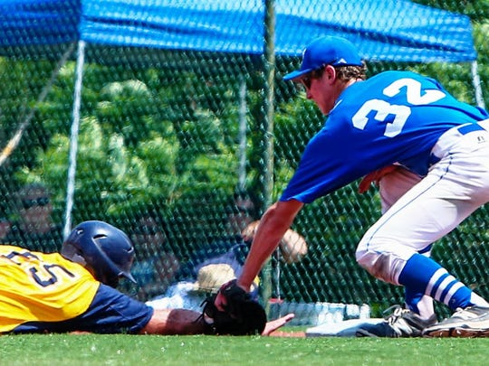 Catholic Central first baseman Nick Sykes (32) makes