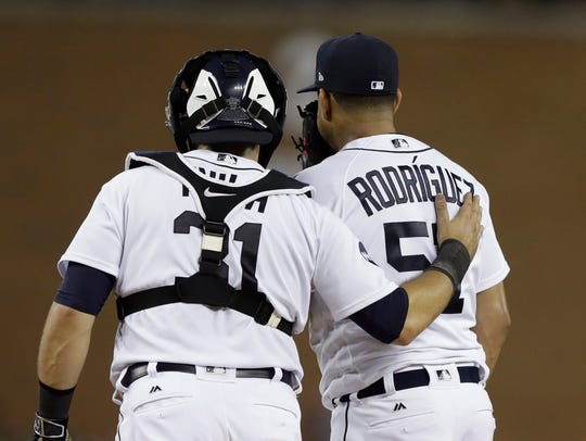 Tigers catcher Alex Avila talks to relief pitcher Francisco