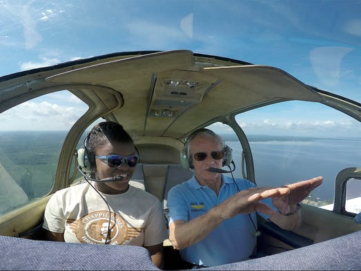 Nyasia Legg, left, learns more about flying from pilot