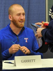 Texas Rangers Right Handed Pitcher, Reed Garrett, gave fans autographs Friday afternoon during the team's winter caravan trip through Wichita Falls and Sherman/Denison held at the MPEC.
