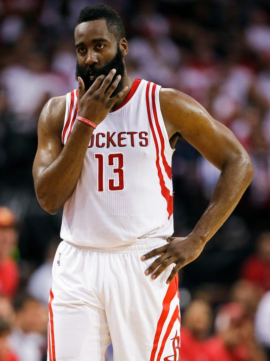 Houston Rockets guard James Harden walks the court late in the second half in Game 3 of an NBA basketball second-round playoff series against the San Antonio Spurs, Friday, May 5, 2017, in Houston. San Antonio won the game 103-92. (AP Photo/Eric Christian Smith)