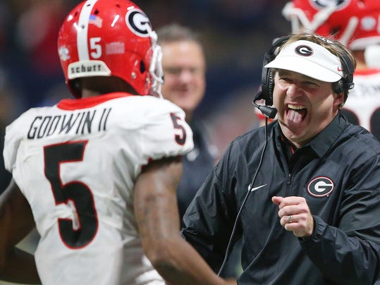 Georgia head coach Kirby Smart reacts after Georgia wide receiver Terry Godwin (5) scored a touchdown against Auburn during the second half of the Southeastern Conference championship NCAA college football game, Saturday, Dec. 2, 2017, in Atlanta. (AP Photo/John Bazemore)