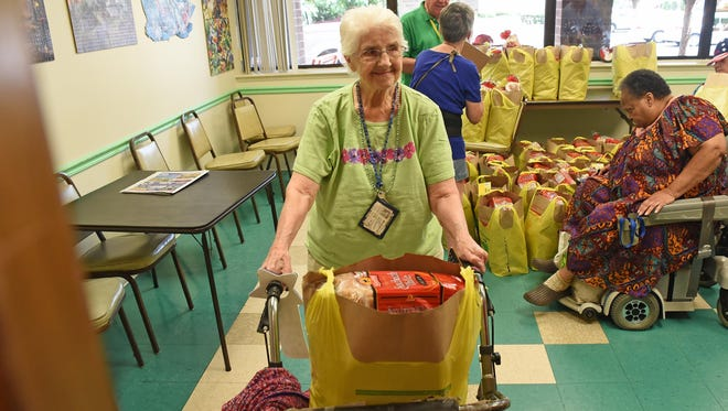 The Italian Cultural Foundation handed out 108 bags of groceries to the residents Jaycee Plaza in Millville, including Lee McGuire here. Aug. 5, 2015.