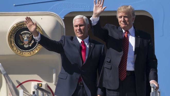 President Donald Trump and Vice President Mike Pence wave to supporters at Phoenix Sky Harbor International Airport on Aug. 22, 2017.