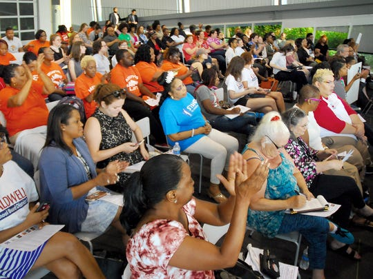 July 19, 2018 - Attendees respond to comments from school board candidates during Thursday's Shelby County Schools forum co-hosted by Chalkbeat and held at Bridges, USA.