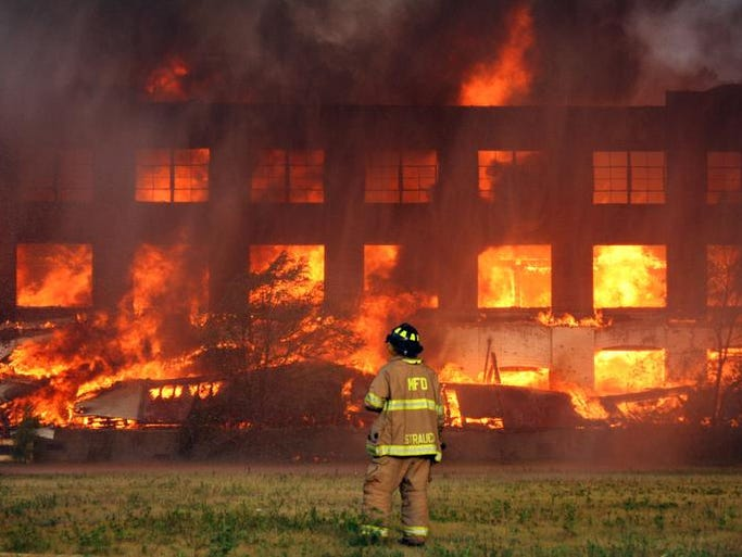 Muncie Fire Department battles a massive abandoned warehouse fire on Saturday morning, July 26. All available firefighters and trucks were called to the blaze, which created enough black smoke it could be seen from anywhere in the city. The structure is a former piano factory with a wood-frame interior, built in 1895.