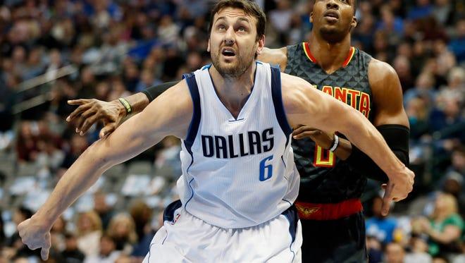 Dallas Mavericks center Andrew Bogut (6) blocks out Atlanta Hawks center Dwight Howard (8) in the first quarter at American Airlines Center.