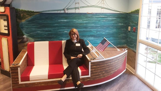Cynthia Garrett, marketing manager at Brighton's Caretel Inns, sits in one of the facility's recently redesigned hallways.