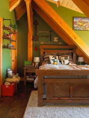 The Adirondacks feel extends to the kids' bedrooms.