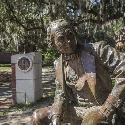 A statue of Francis Eppes  sits in front of Westcott