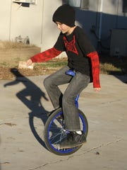 Ocean Hutchins showed off his unicycling skills in his driveway.