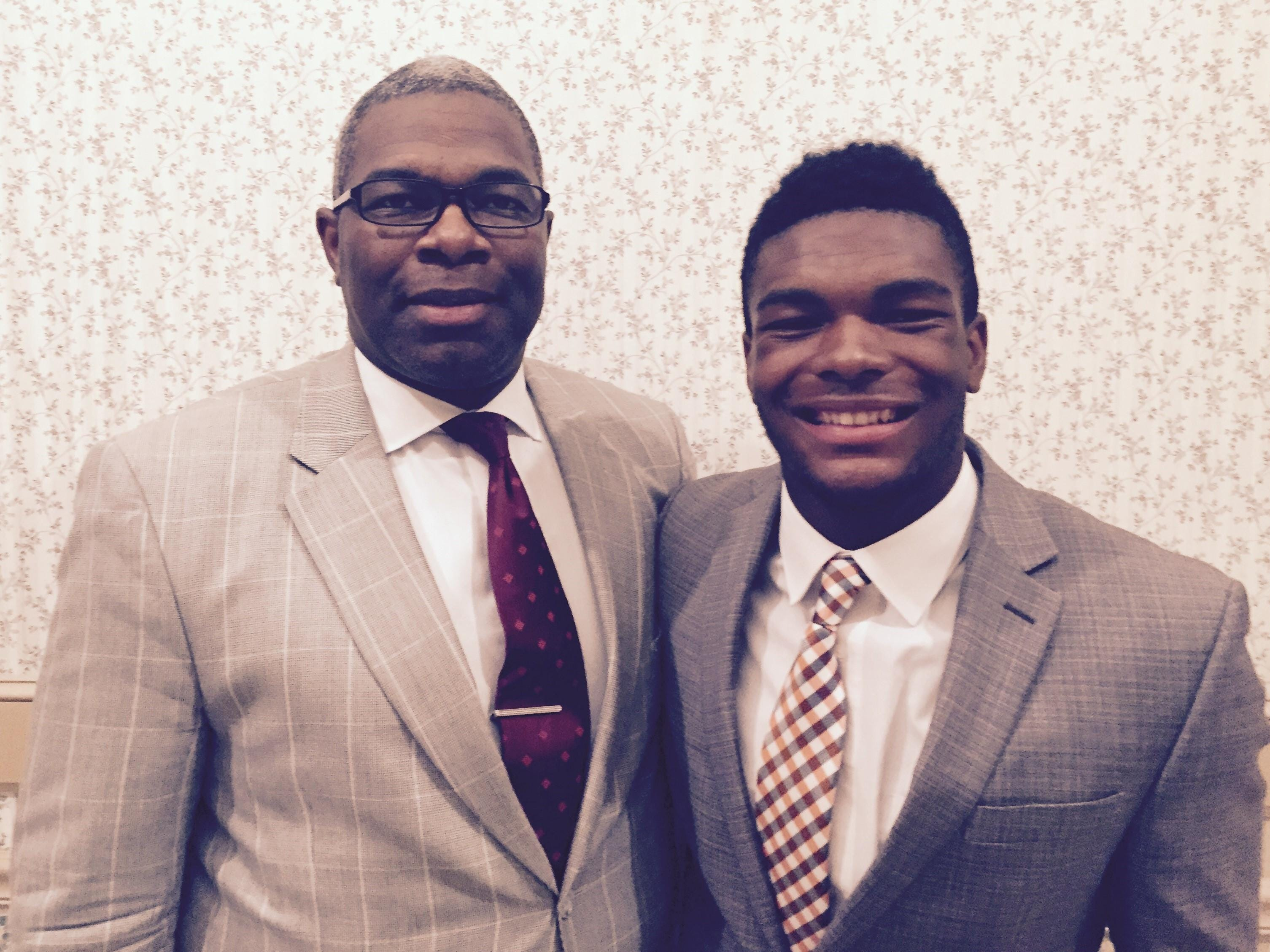 Former Eagles linebacker Marc Woodard with his son, Marc, at the Taliaferro Foundation banquet.