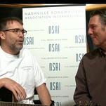 Tony Martin, left, with Bart Herbison, executive director of Nashville Songwriters Association International