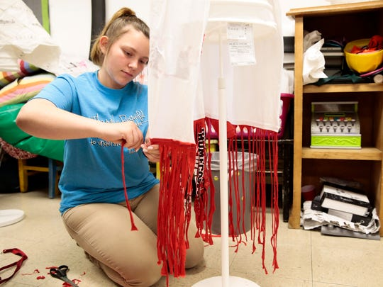 Gabriella Caldwell uses a torn t-shirt to make a dress for an upcoming fashion show using non-traditional materials at Edgar Martin Middle School in Lafayette Monday, April 10, 2017.