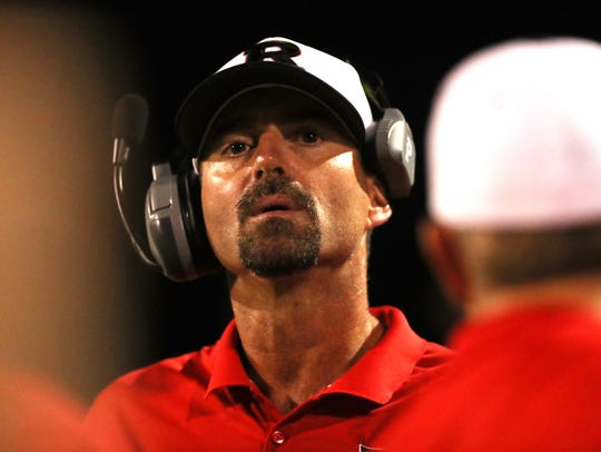Rossview Head Coach Todd Hood watches the action against