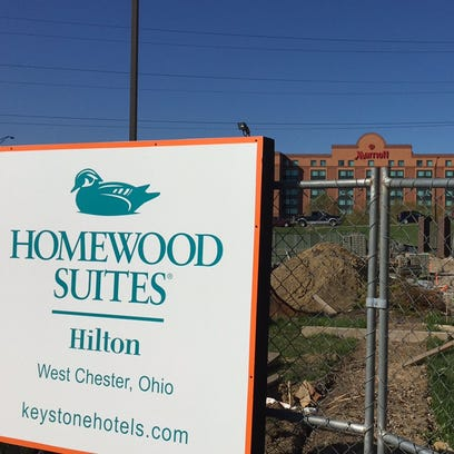 The 112-room Hilton Homewood Suites next to the booming I-75 and Union Centre Boulevard interchange will be the next new hotel. In background is the Marriott North Hotel, which opened in 2000 and for years was the only major hotel at the interchange, which will soon feature nine large hotels.