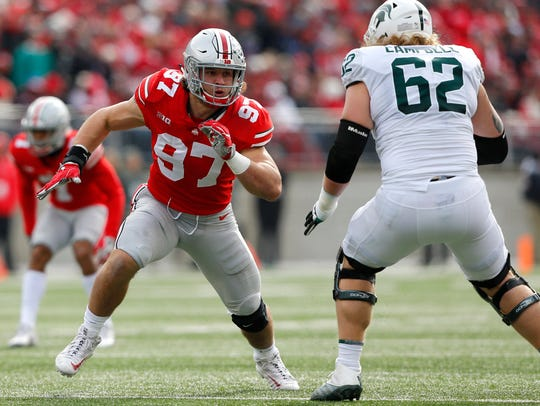 Ohio State's Nick Bosa rushes around Michigan State's