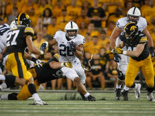 Penn State running back Saquon Barkley breaks free