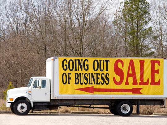 """Going out of business sale"" sign on a truck."