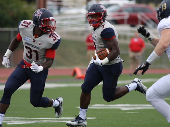 Shippensburg's Allen Holman (7) runs back an interception