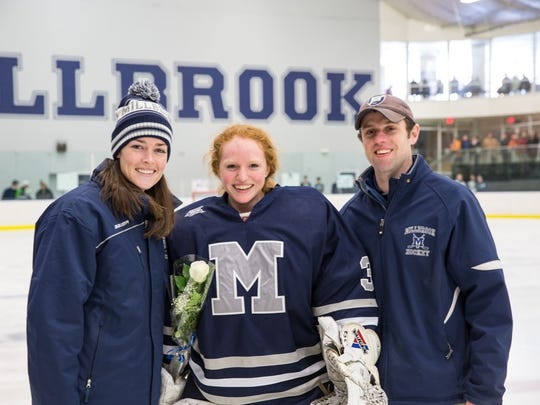 Head Girls Varsity Hockey Coach Ed Allen with Assistant Coach Ana Steele-Norton and Morgan Moffat at Millbrook's senior night celebration earlier this year.
