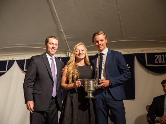Athletic Director Ed Allen awards the Frederick W. Knutson Trophy to 2015 graduates Gianna Muscari and Jacob Moreau